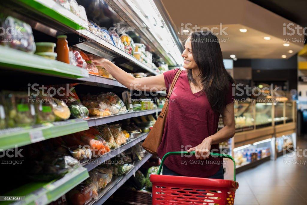 Woman at supermarket stock photo