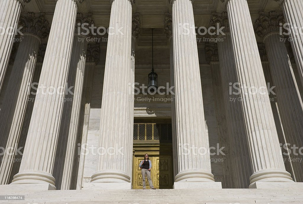 Woman at Supreme Court A young woman standing at the top of the US Supreme Court steps Achievement Stock Photo