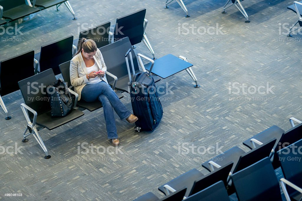 Woman at the airport stock photo