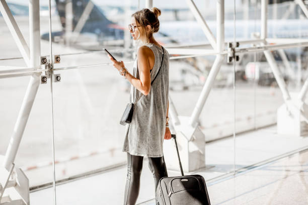woman at the airport - airport stock photos and pictures