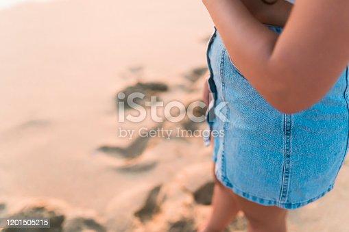 928866530 istock photo Woman at the beach Close Shot 1201505215
