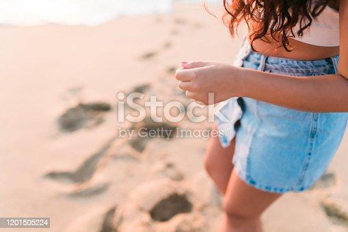 928866530 istock photo Woman at the beach Close Shot 1201505224