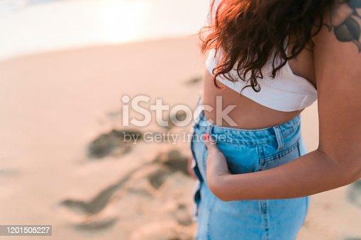 928866530 istock photo Woman at the beach Close Shot 1201505227