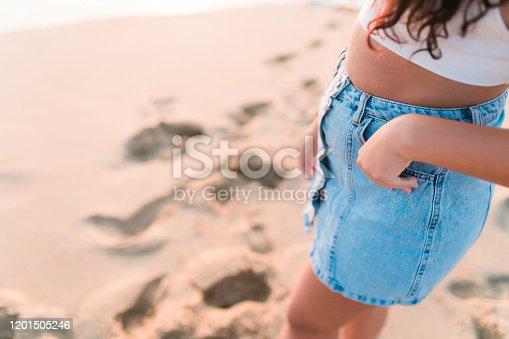 928866530 istock photo Woman at the beach Close Shot 1201505246