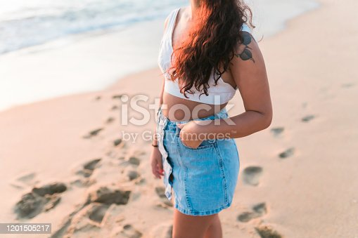 928866530 istock photo Woman at the beach 1201505217
