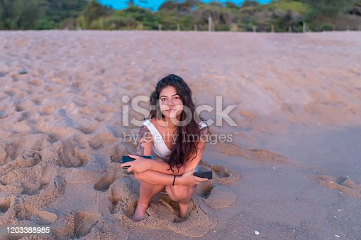 928866530 istock photo Woman at the beach 1203388985
