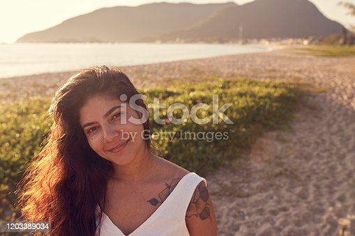 928866530 istock photo Woman at the beach 1203389034