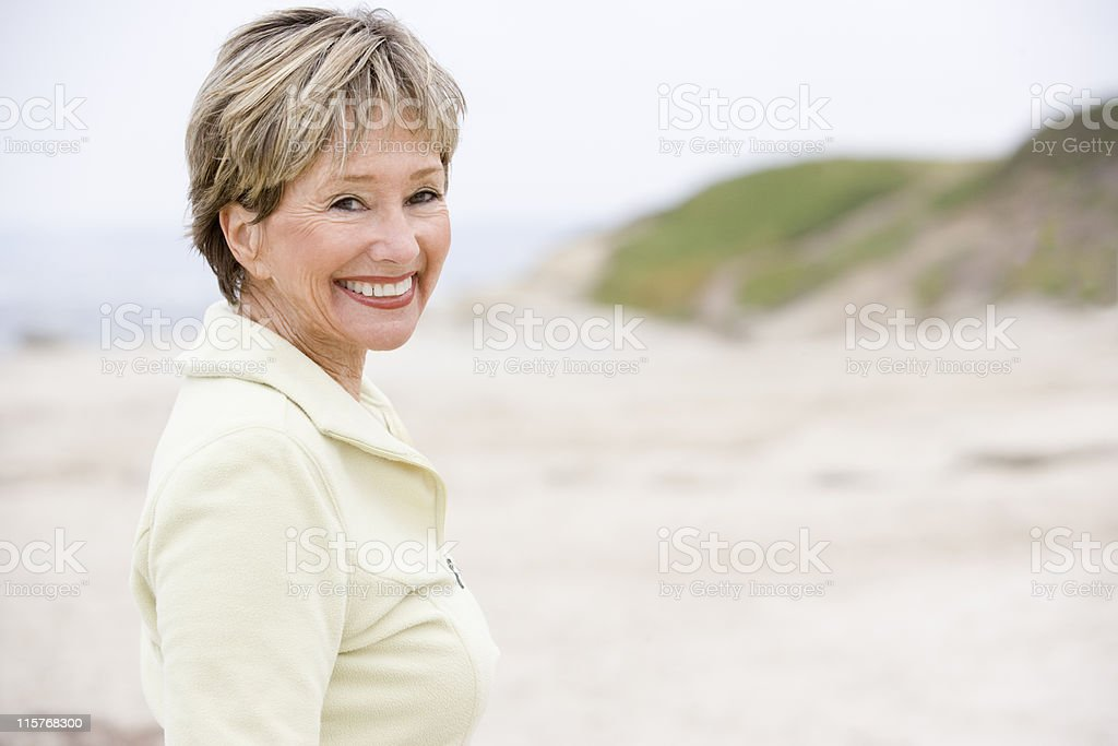 Woman at the beach smiling stock photo