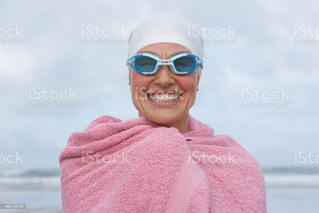 woman at the beach wrapped in a towel stok fotoğrafı