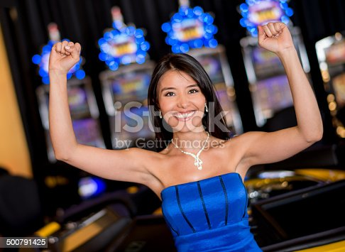 Woman winning at the casino and looking very happy