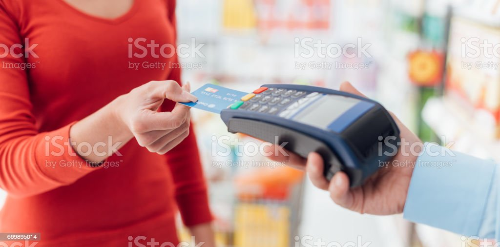 Woman at the checkout stock photo