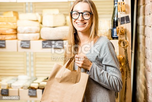 istock Woman at the cheese shop 886949832