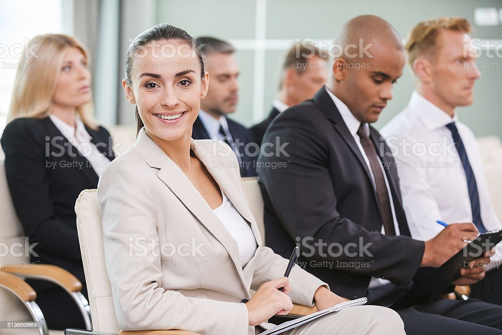 Woman at the conference. stock photo