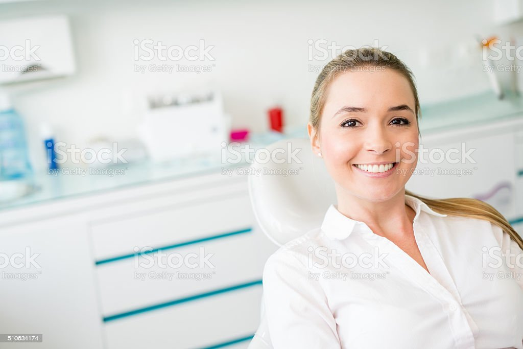 Woman at the dentist stock photo