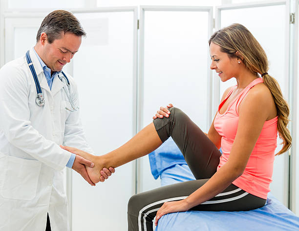woman at the doctor - sports medicine stock photos and pictures