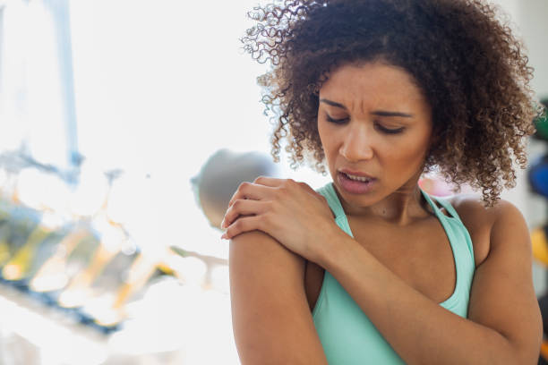 Woman at the Gym Experiencing Pain stock photo