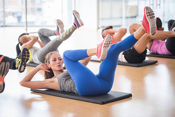 woman at the gym in an aerobics class - aerobics stock photos and pictures