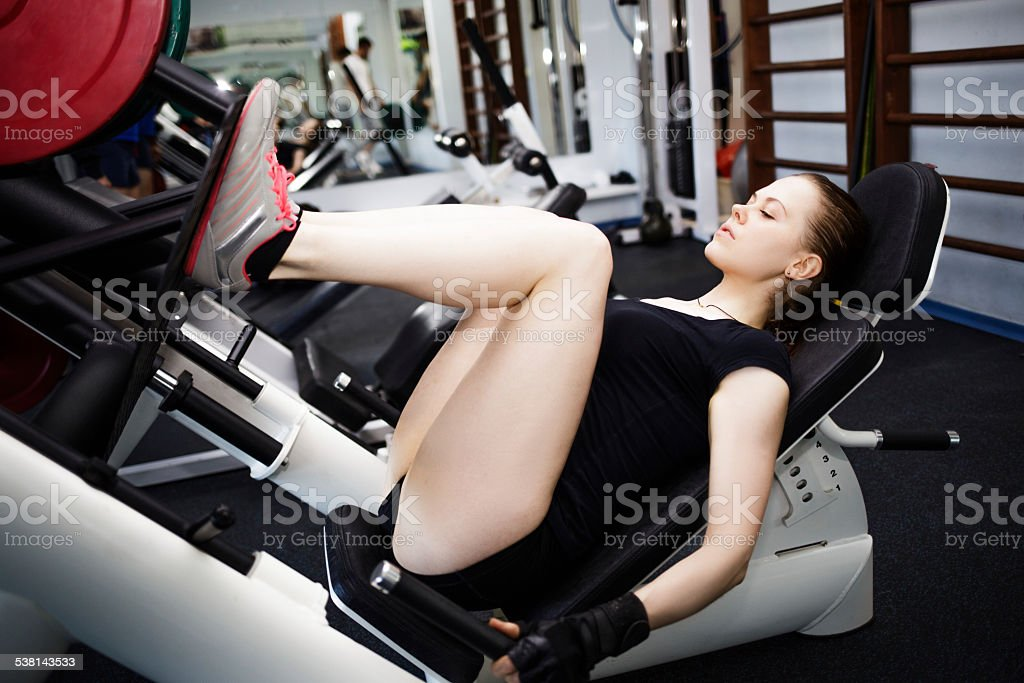 Woman at the gym on a sports simulator stock photo