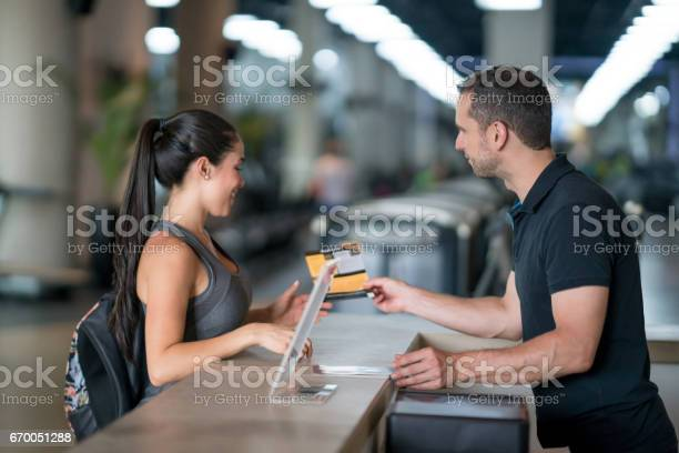 Woman at the gym talking to receptionist about membership plans picture id670051288?b=1&k=6&m=670051288&s=612x612&h=kooy5gogkc84slwwsp4aw3kxcw qllzvuwit7bspi6c=