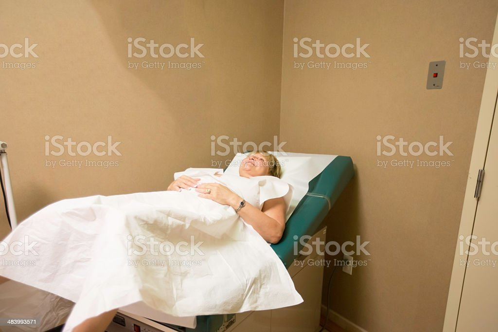 Woman at the gynecologist stock photo