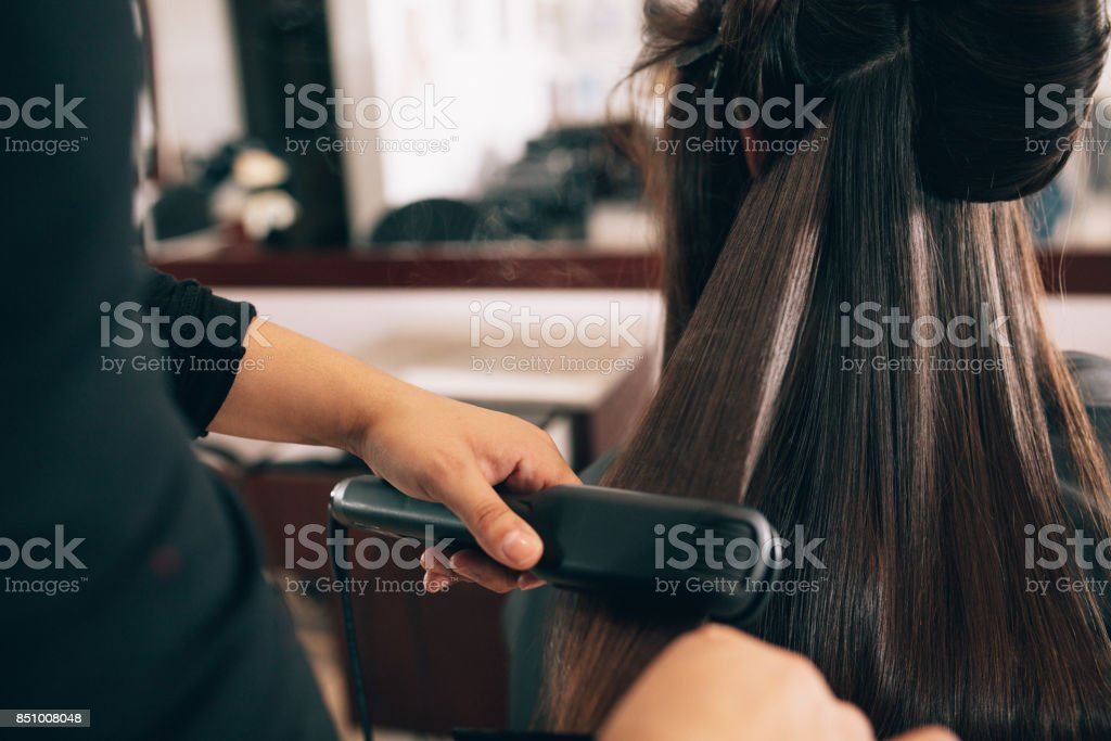 Woman at the hair salon getting her hair styled stock photo