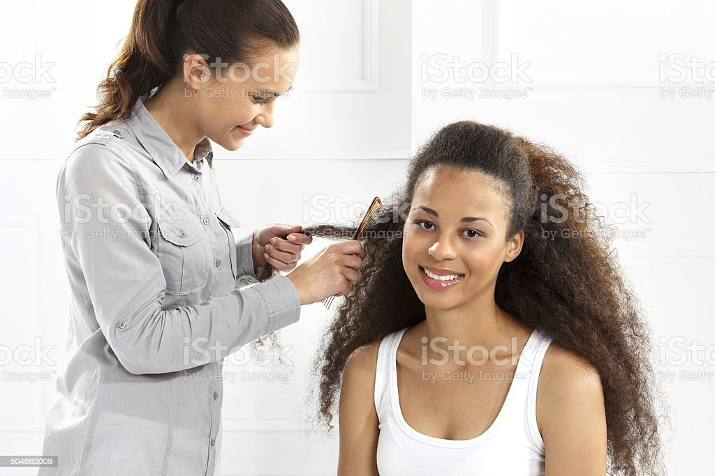 Woman at the hairdresser stock photo