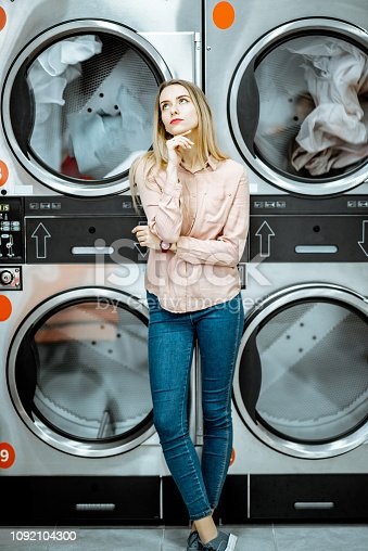 istock Woman at the laundry 1092104300