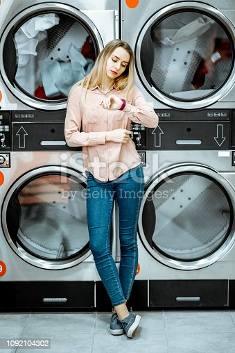 istock Woman at the laundry 1092104302