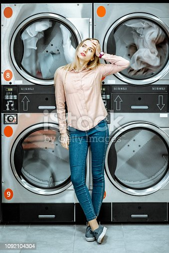 istock Woman at the laundry 1092104304