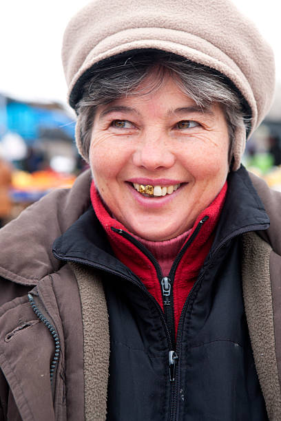 woman at the market - gold tooth stock photos and pictures