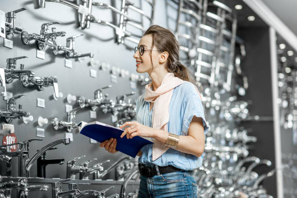 woman at the plumbing shop - catalogue stock photos and pictures