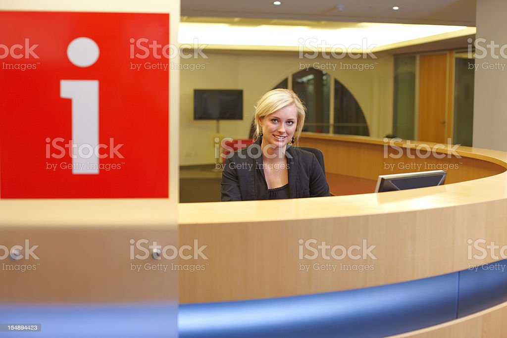 Woman at the reception desk royalty-free stock photo