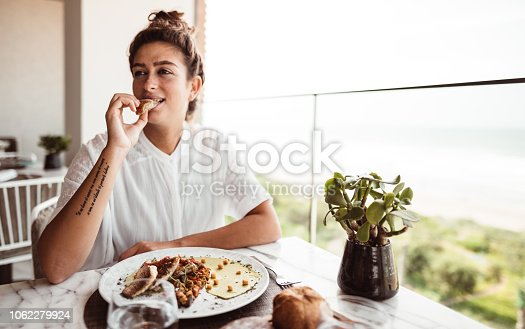woman at the restaurant eating maroccan food