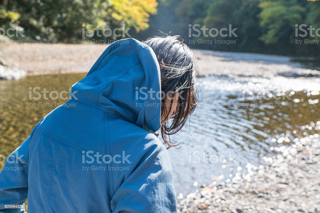 Woman at the river stock photo