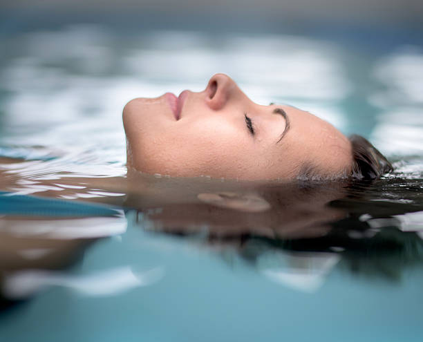 Woman at the spa relaxing at the swimming pool - Photo