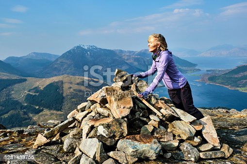 istock Woman at the summit of the Pap of Glencoe, Scotland 1281439755