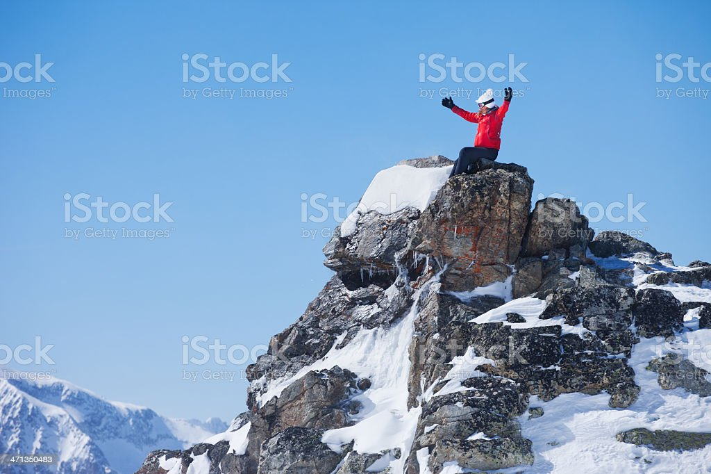 Woman at the top of a mountain stock photo