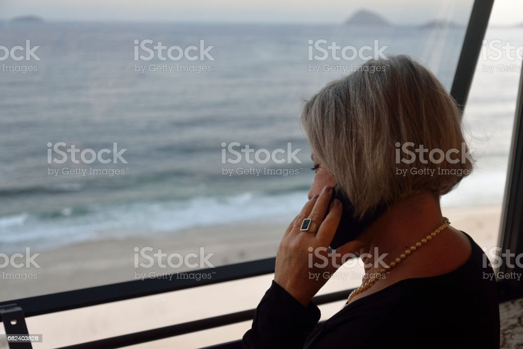 Woman at the window of hotel room royalty-free stock photo