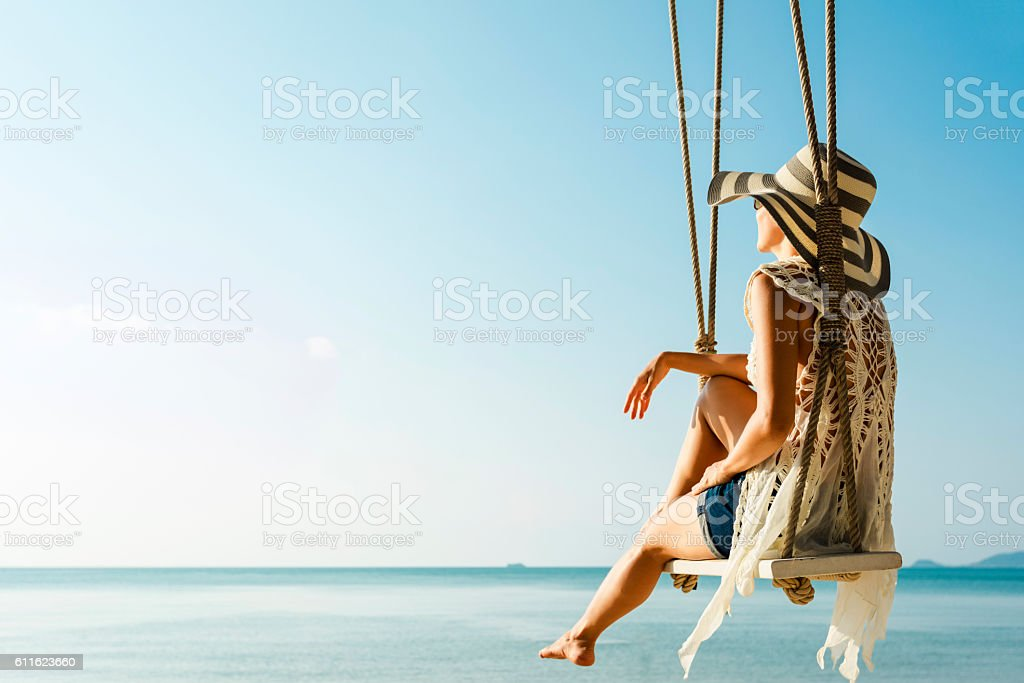 Woman at tropical swing - foto stock