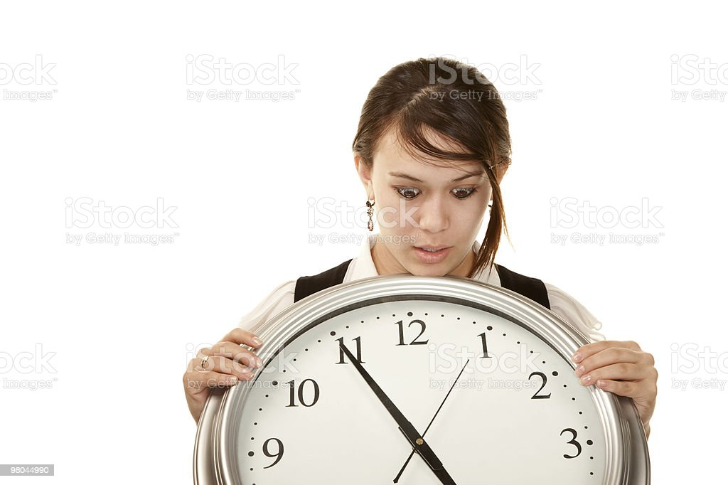Woman at work holding large clock royalty-free stock photo