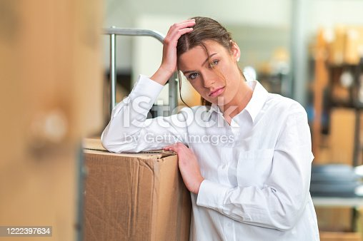1001622522 istock photo Woman at work is sad 1222397634