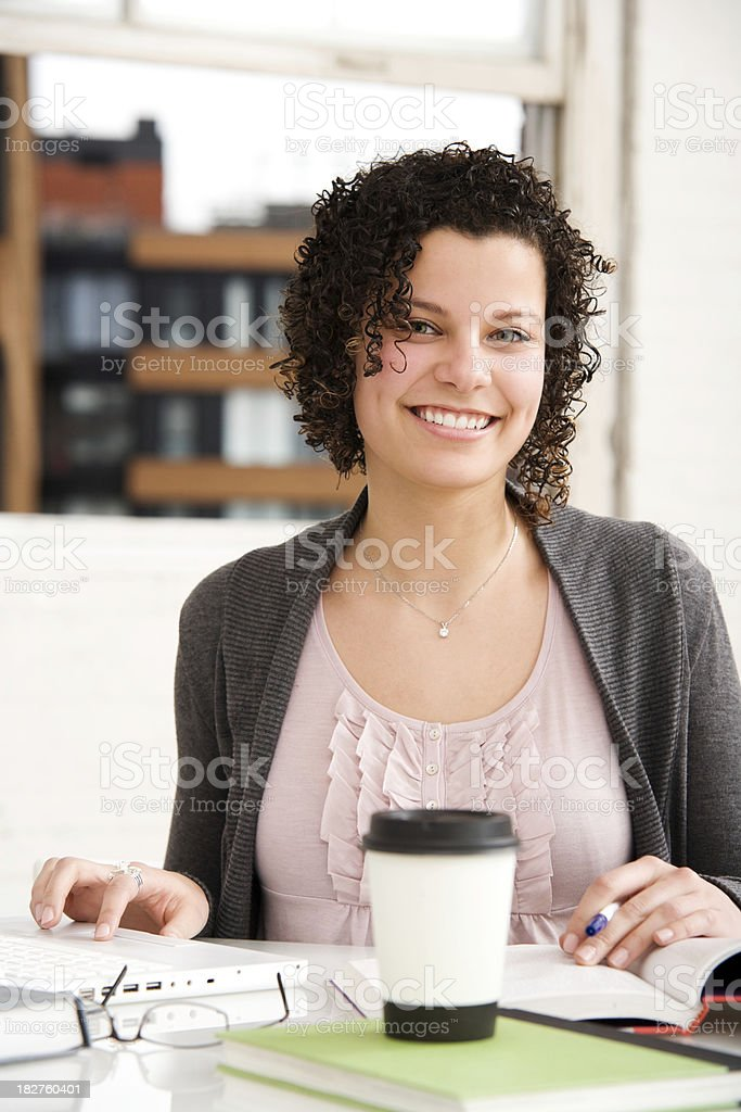 Woman at Work Using Laptop in Home or Office royalty-free stock photo