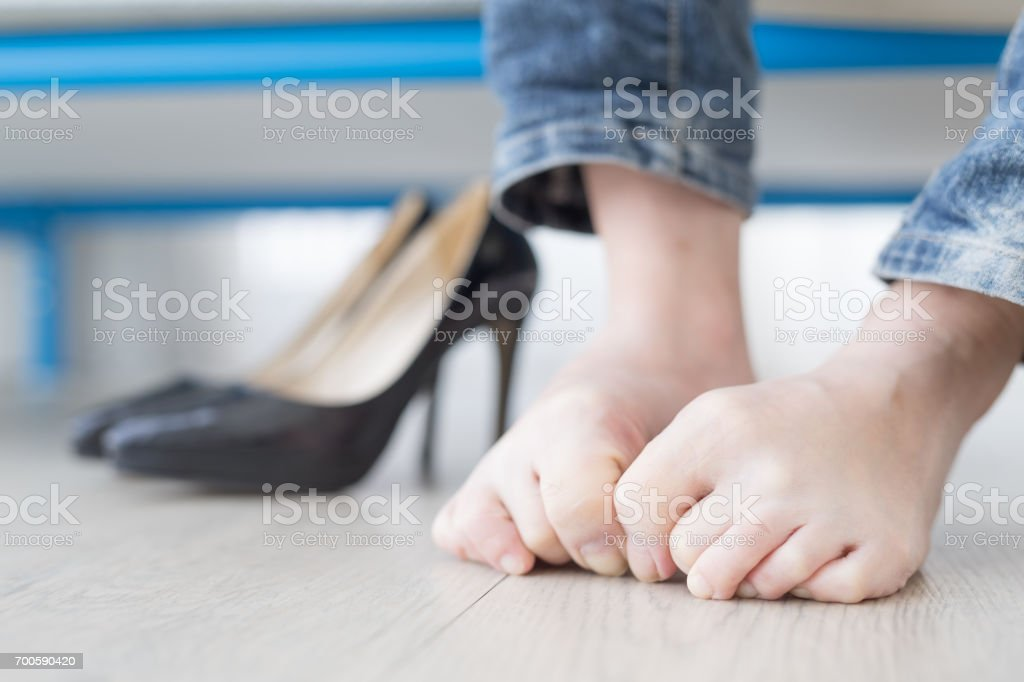 woman athlete foot stock photo