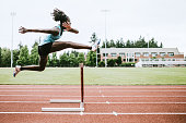 istock Woman Athlete Runs Hurdles for Track and Field 993744768