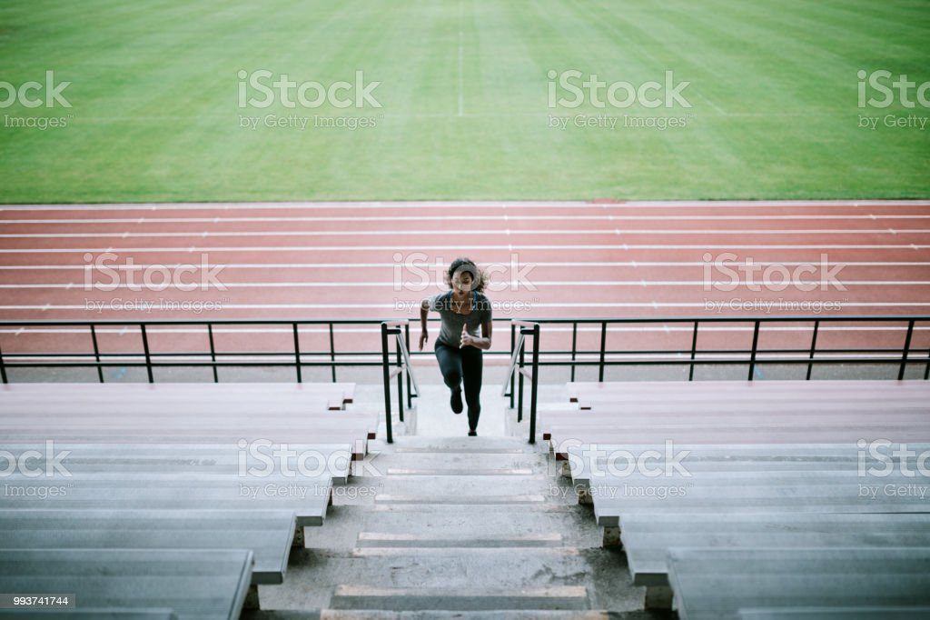 Woman Athlete Runs Stairs for Track and Field stock photo