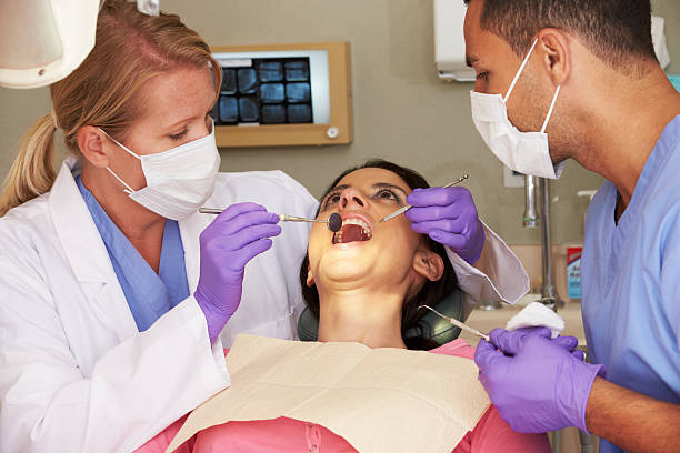 a woman attending a dentistry check up appointment - dental assistant stock photos and pictures