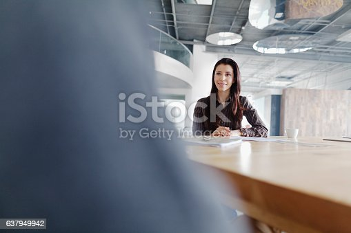 istock Woman attending business meeting in large studio office 637949942