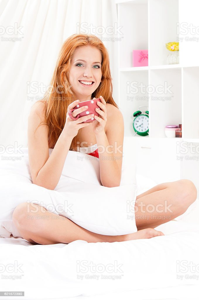 Woman awaking with cup of coffee photo libre de droits