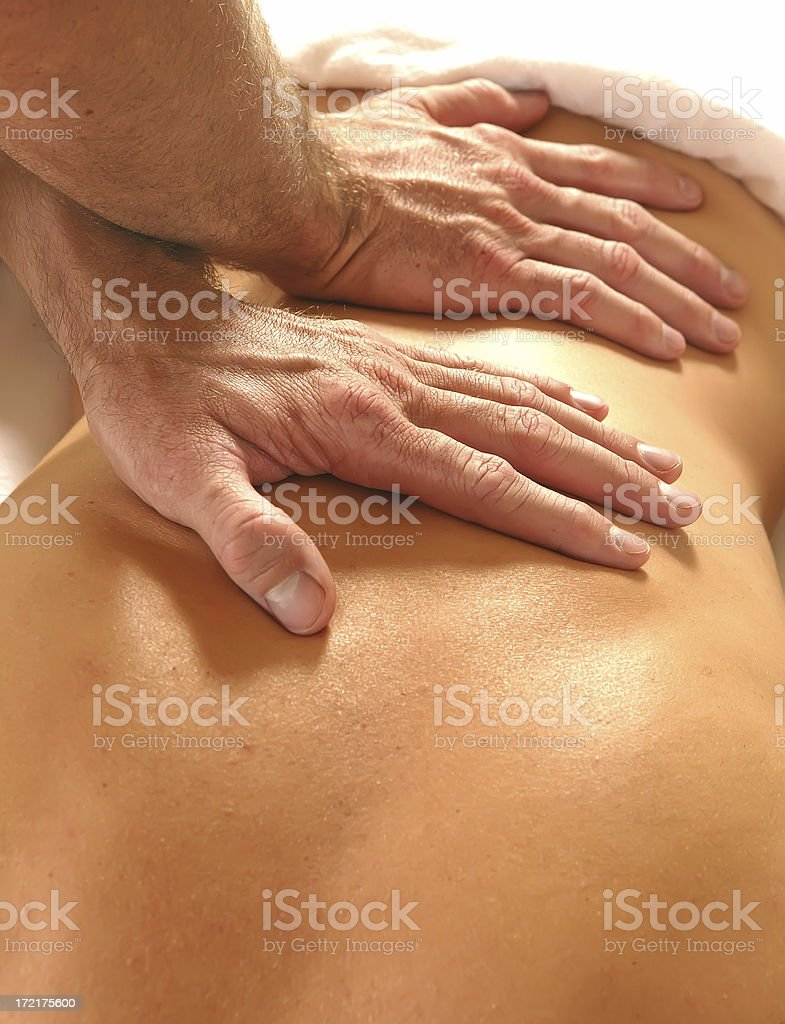 woman back getting a massage by men hands royalty-free stock photo