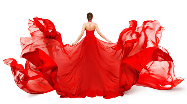 Woman Back Rear view in Red Flying Dress Fluttering on Wind, Girl in Blowing Waving Gown Clothes on White stock photo